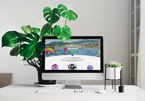 mockup-of-an-imac-placed-on-a-minimalistic-table-by-a-houseplant-36572-r-el2